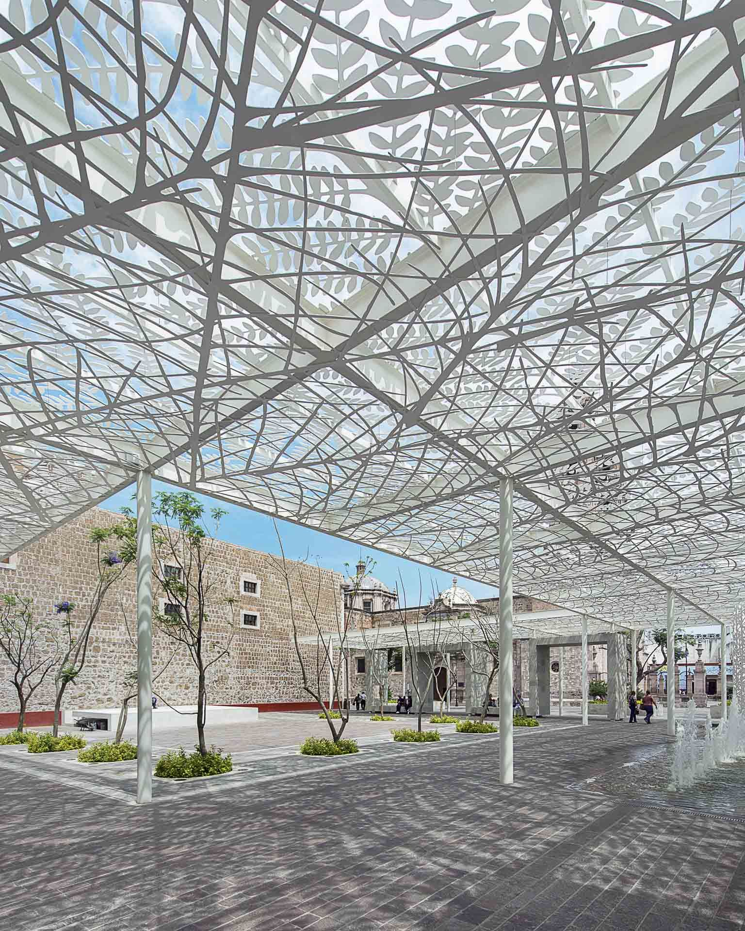 Photo of perforated metal canopy casts shadows at for Steel shade structure design