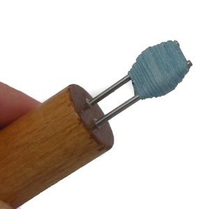 Image of finished double hole paper bead before removing it from the tool