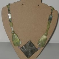 With a main stone of greenish jasper this necklace also includes a little bit of jade, possible some flourite and other jasper stones.