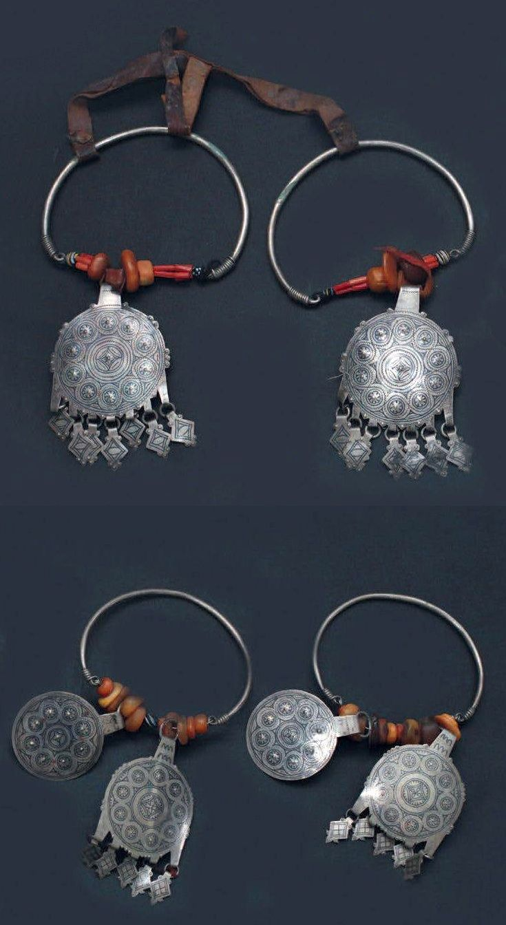 Morocco | Two pairs of temporal ornaments / earrings | Akhsass, Aït Ba Amran | Silver, coral, amber and glass paste. One pair is connected with a leather cord |