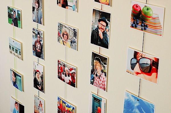 Ideas For Hanging Pictures On Wall Without Frames magnetic photo rope - a cool way to display your images | magnets