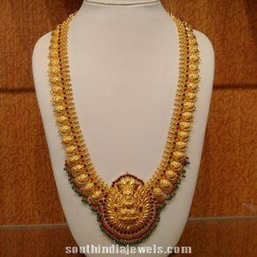 Gold mango haram with lakshmi pendant emeralds pendants and gold aloadofball Image collections