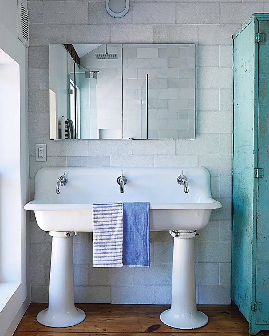 "@dwellmagazine: ""The bathroom features a salvaged 1920s schoolhouse sink from Olde Good Things. The faucet mixers are by Jado; the original single tap openings were enlarged to fit them and the entire sink was re-glazed. Photo by @christophertestani .  Designed by Givonehome #interior #bathroom #sink"""