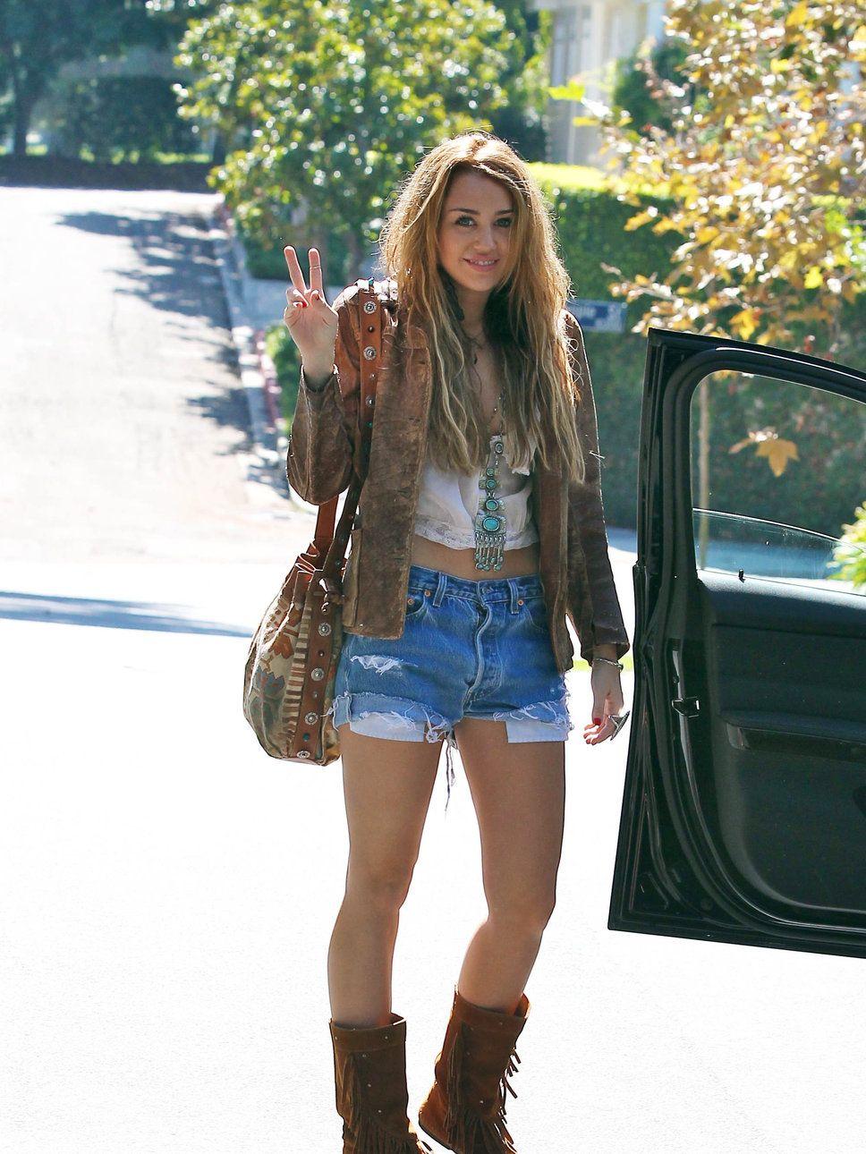 Miley Cyrus denim shorts boots bag jacket necklace peasant crop ...