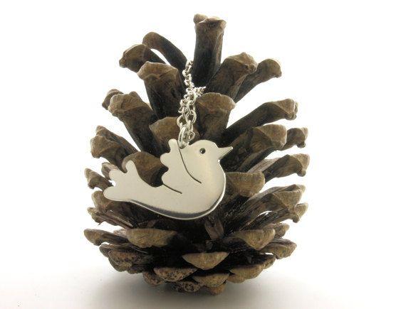 Bird Pendant Necklace in Sterling Silver. £55.00, via Etsy.