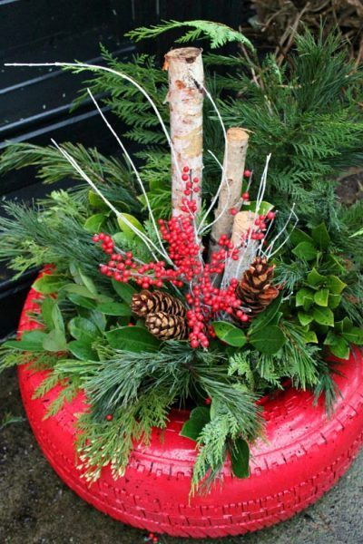 Use a recycled tire to create a beautiful DIY Christmas planter with fresh greenery. Adds a festive, rustic touch to any outdoor Christmas decor. /  #christmasplanter #christmasdecor #outdoorchristmasdecor #christmasDIY #christmasdecoration
