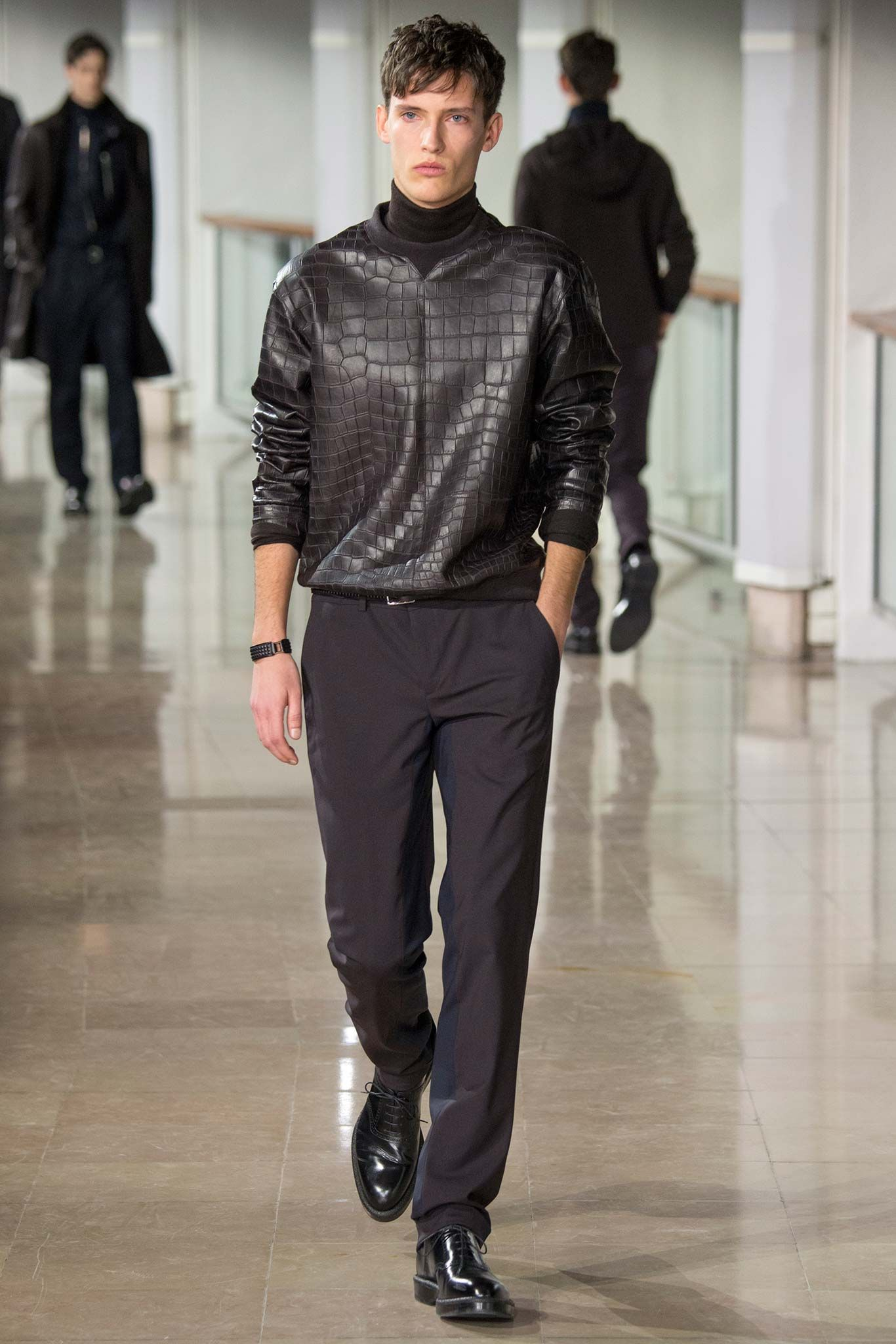 """Hermès Fall 2015 Menswear - Véronique  Nichanian has built her career on alchemizing the most extreme notions of what might constitute """"luxury""""—in the eyes of a world that can scarcely afford it—with the most accessible shapes and forms. Is a sweatshirt still a sweatshirt if it comes in crocodile? It's a question very few designers are ever in a position to ask. To Nichanian's credit, she's managed to ask and answer such conundrums over and over again. it's a sweatshirt, and you want it…now."""