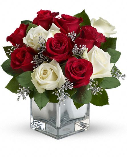 Teleflora's Snowy Night winter bouquet of red and white roses