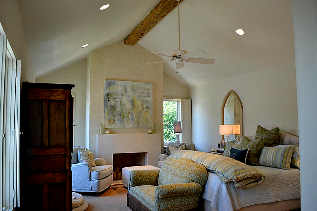 Cathedral Ceiling With Recessed Lights And Ceiling Fan From Beam