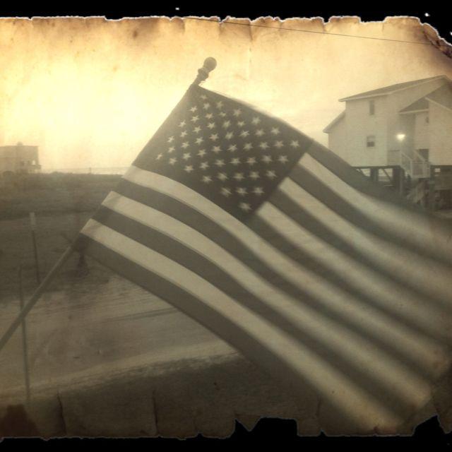7b09471cec1b American flag flying on the gulf cost.