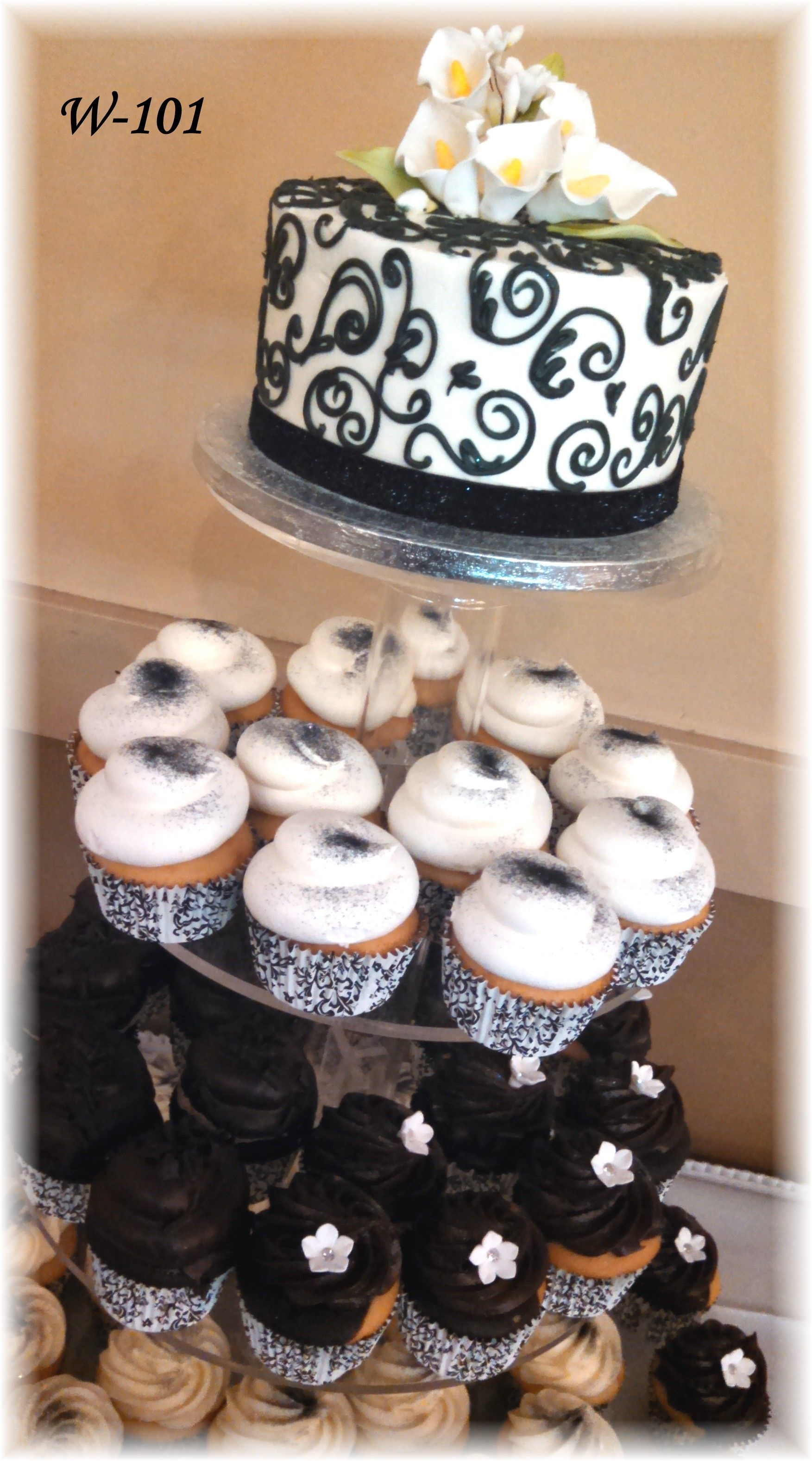 Black and white wedding cupcakes with glitter and Calla