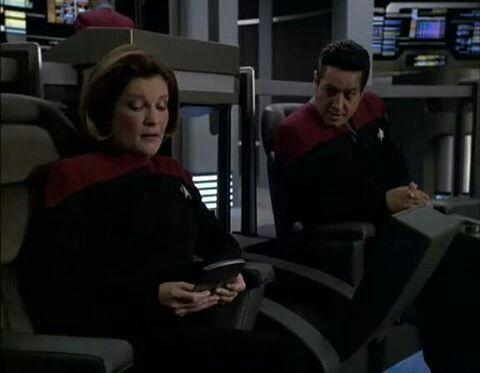Chakotay wondering what Janeway is reading lol