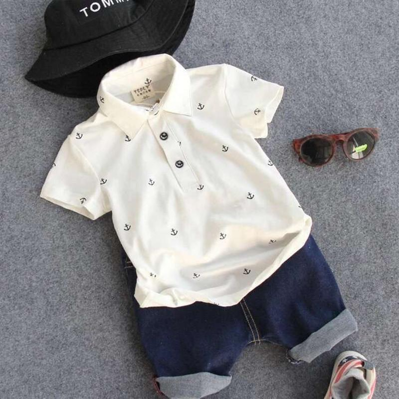 20a7958e0ce4 It's time to get on a boat with this nautical boys two piece polo and shorts  set. Rock the navy or beige; either way, your little fox will be ready to  leave ...