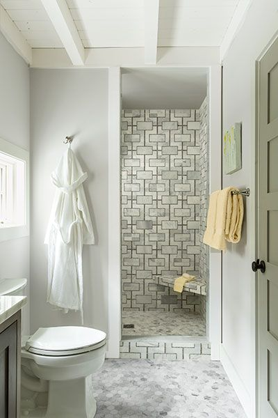 the shower is lined with tilebars cul de sac athens gray a sophisticated marble mosaic tile befitting a master bath a robe hook on the wall beside the - Mosaic Tile House 2015