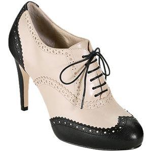 Cream and black oxford heels.