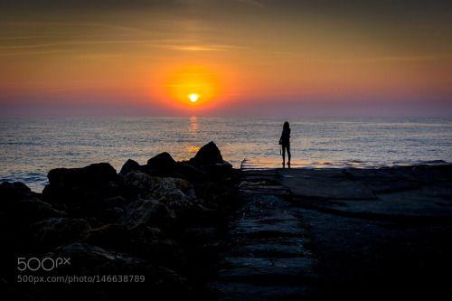 Watching the Sun Rise by alexvlad985  sunrise girl sea sun rocks silhouette seascape seashore black sea romania alexvlad985