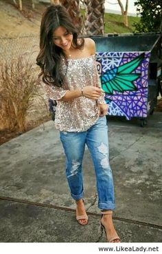 Glitter top and boyfriend jeans.