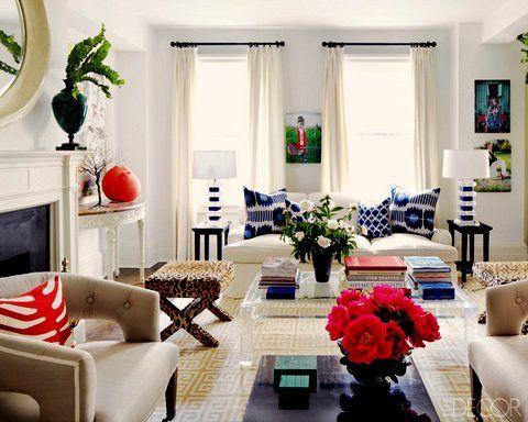 living room. lights walls, lights sofa, bright pillows?!?! Bright living room