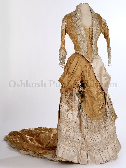 1880 wedding dress:  bustle gown of golden champagne-colored brocade silk satin bodice front has floral design of beads and satin embroidery extending from center back down bodice front, fabric inset forms center closure with 11 buttons.