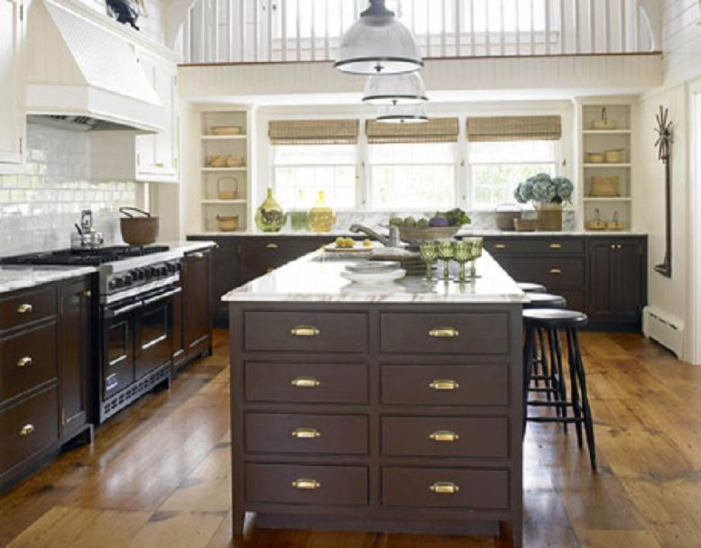 Kitchen With Brown Cabinets And Golden Knobs | Kitchen cabinet knobs ...