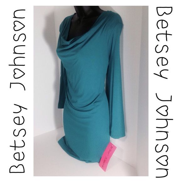 Betsey Johnson Zipper Teal Dress - Size 8 This is missing the slip, but I don't see the need for it. Style#: FC03K05. Color: TealMulti, the picture looks more blue, but it's teal. 95% Rayon / 5% Spandex. Now this dress is new to me.  On each side of the dress there is one side of the zipper.  You put the two sides together and zip it to where you want it.  I tried to show it in the pictures.  You can wear it zipped or not.  Now, the one I have been wearing I didn't realize it until I had to…