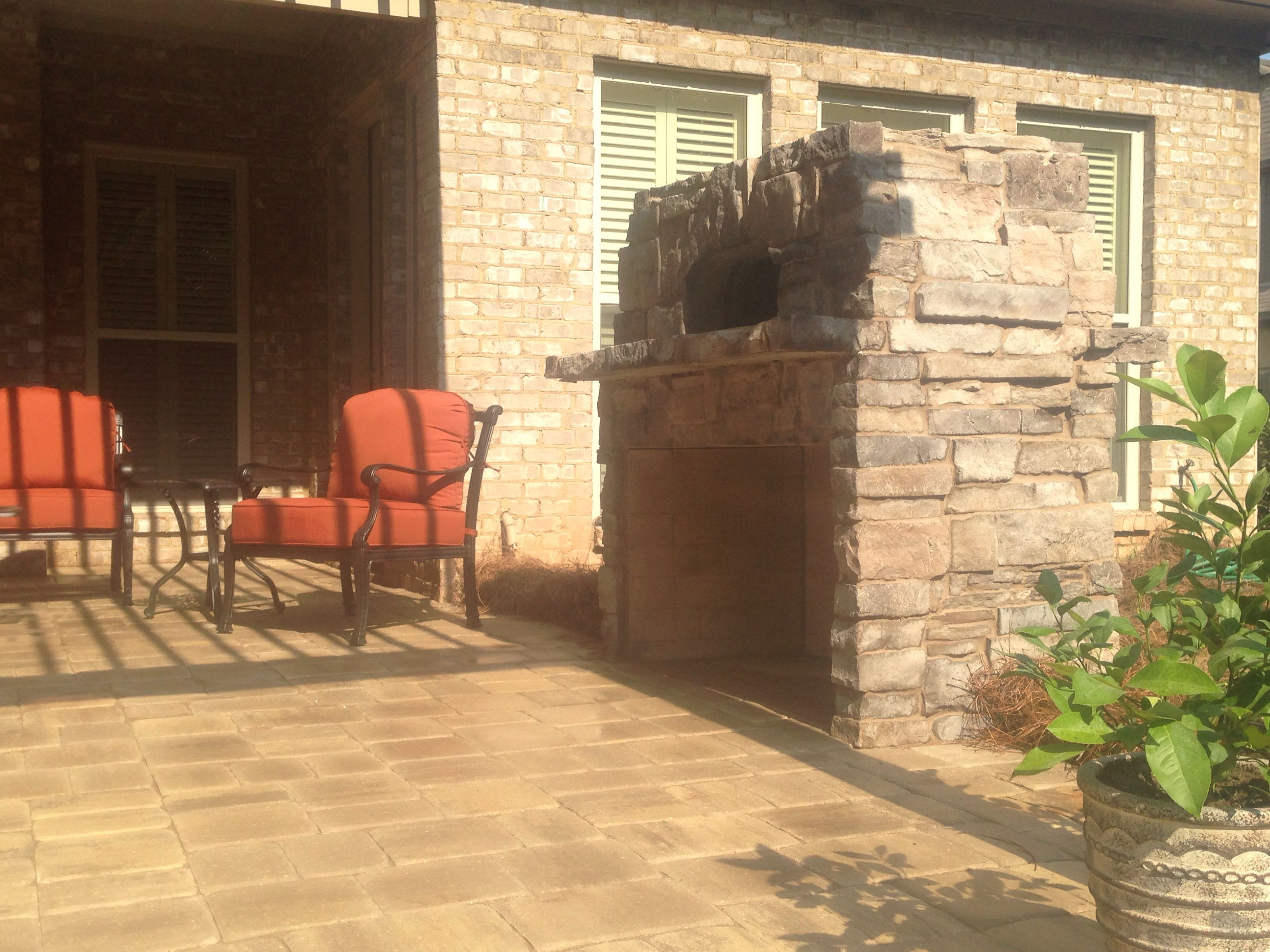 Stone Pizza Kitchen over Fireplace  Southern Hardscapes   www.southernhardscapesal.com