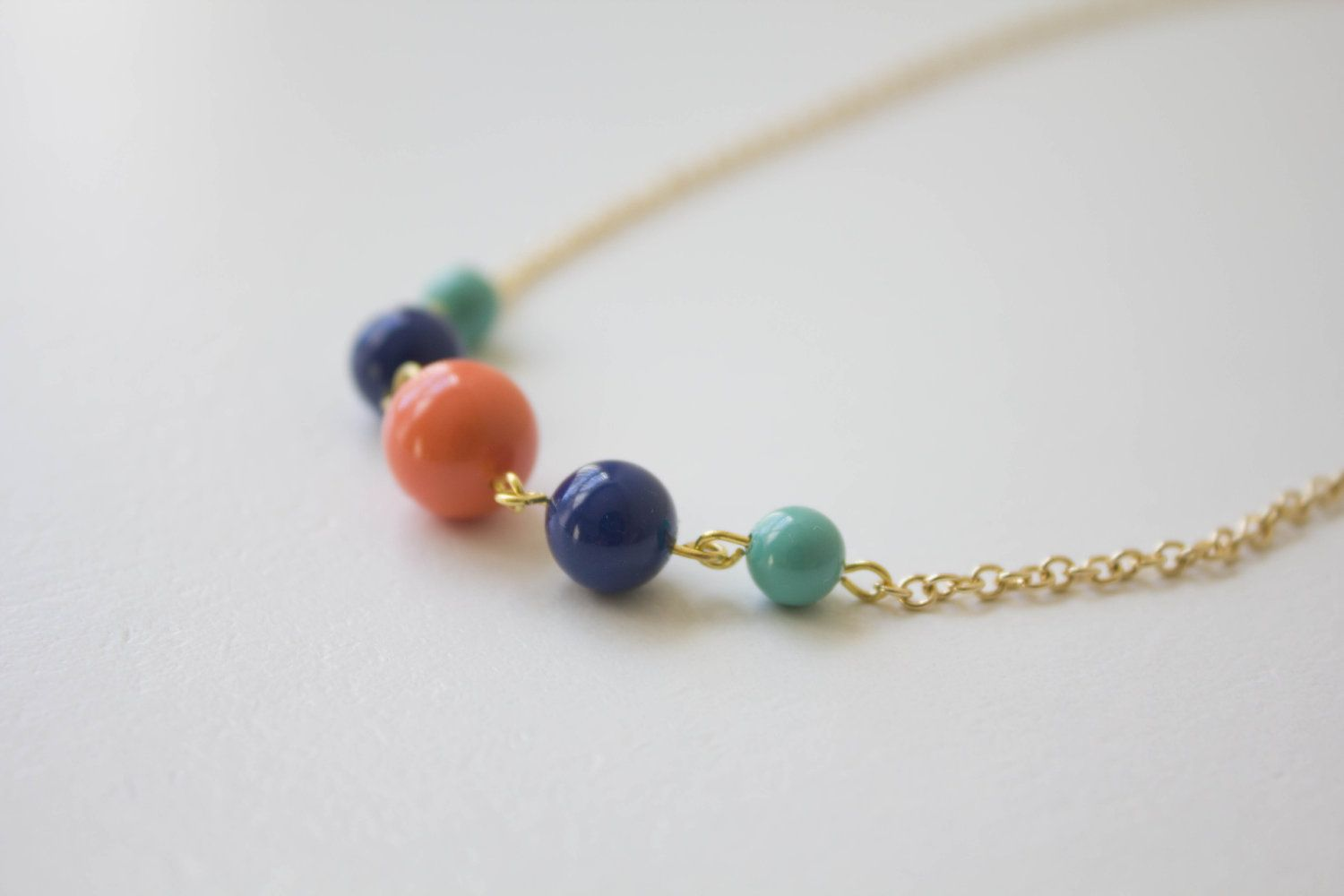 Necklace with 5 colorful pearls; Etsy.