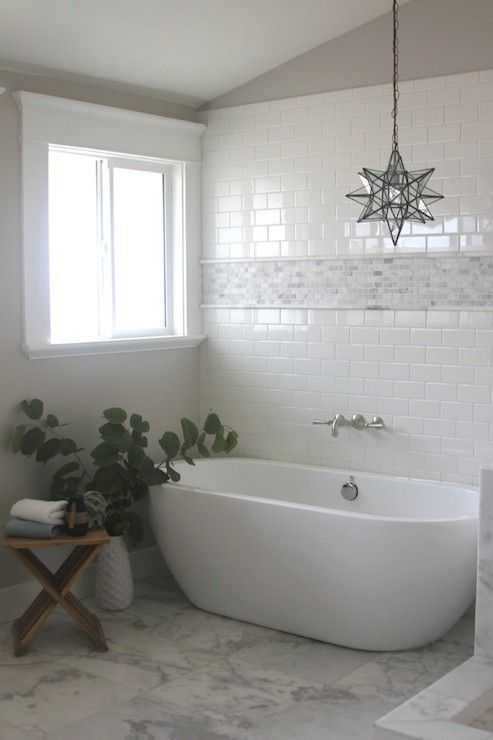 Gorgeous Bathroom With Subway Tiled Wall Bordered With A Mini