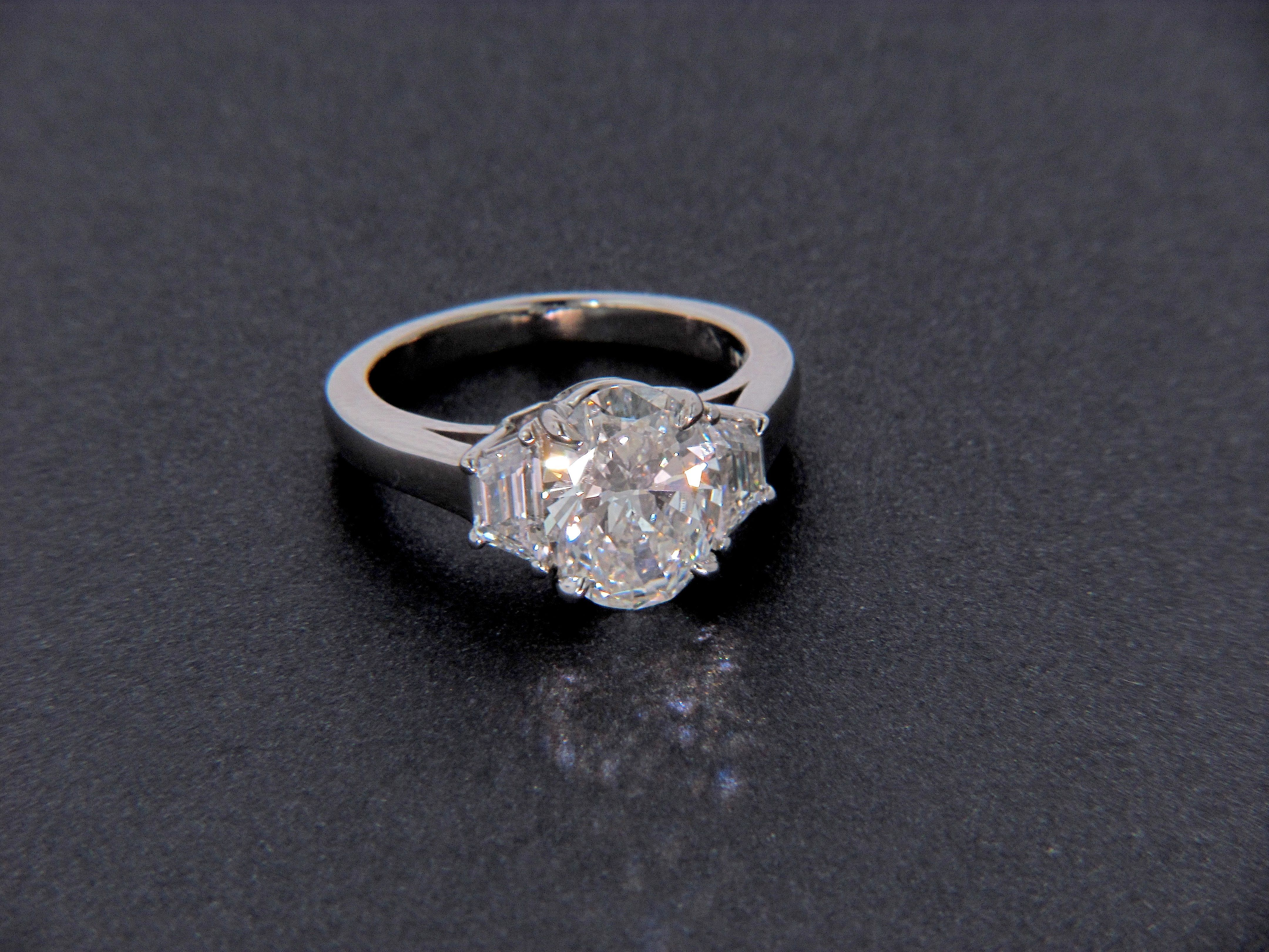 d508f74c4c217 Oval Diamond ring with Trapezoid Side Stones - not a fan of the ...