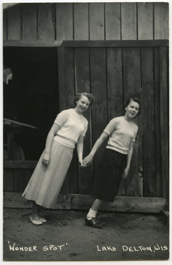 Wonder Spot, Lake Delton, Two women hold hands while demonstrating the visual characteristics of the Wonder Spot.
