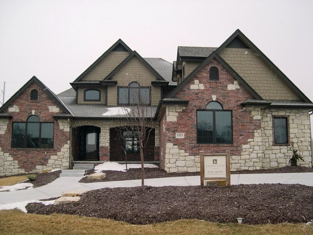 Brick and shingle siding brick or stone appearance for Stucco stone exterior designs