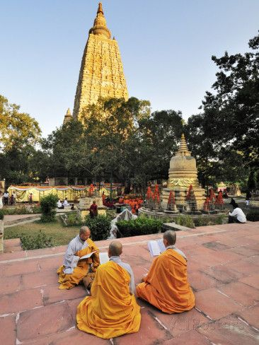 Monks Praying at the Buddhist Mahabodhi Temple, a UNESCO World Heritage Site, in Bodhgaya, India