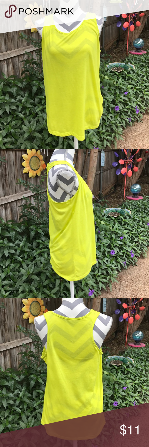 Vibrant yellow tank Beautiful worn alone, in stunning yellow, or worn under a different top!! Lots of stretch and very comfortable! New condition. No size tag, but fits like a L/XL Tops Tank Tops