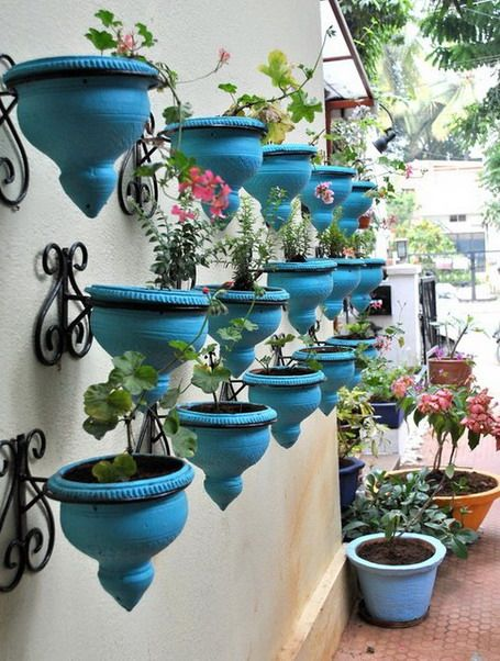 Series of Turquoise Outdoor Planters Pots in Patio Design Ideas