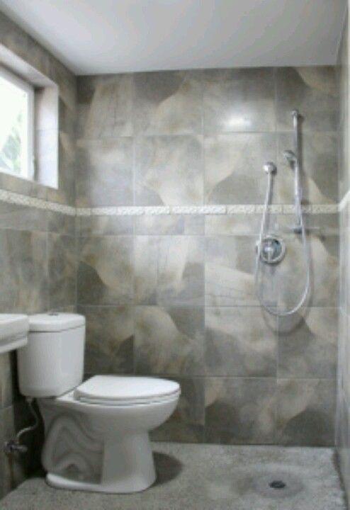 Tiny Bathroom Drain In Floor Eliminates Need For Claustrophobic