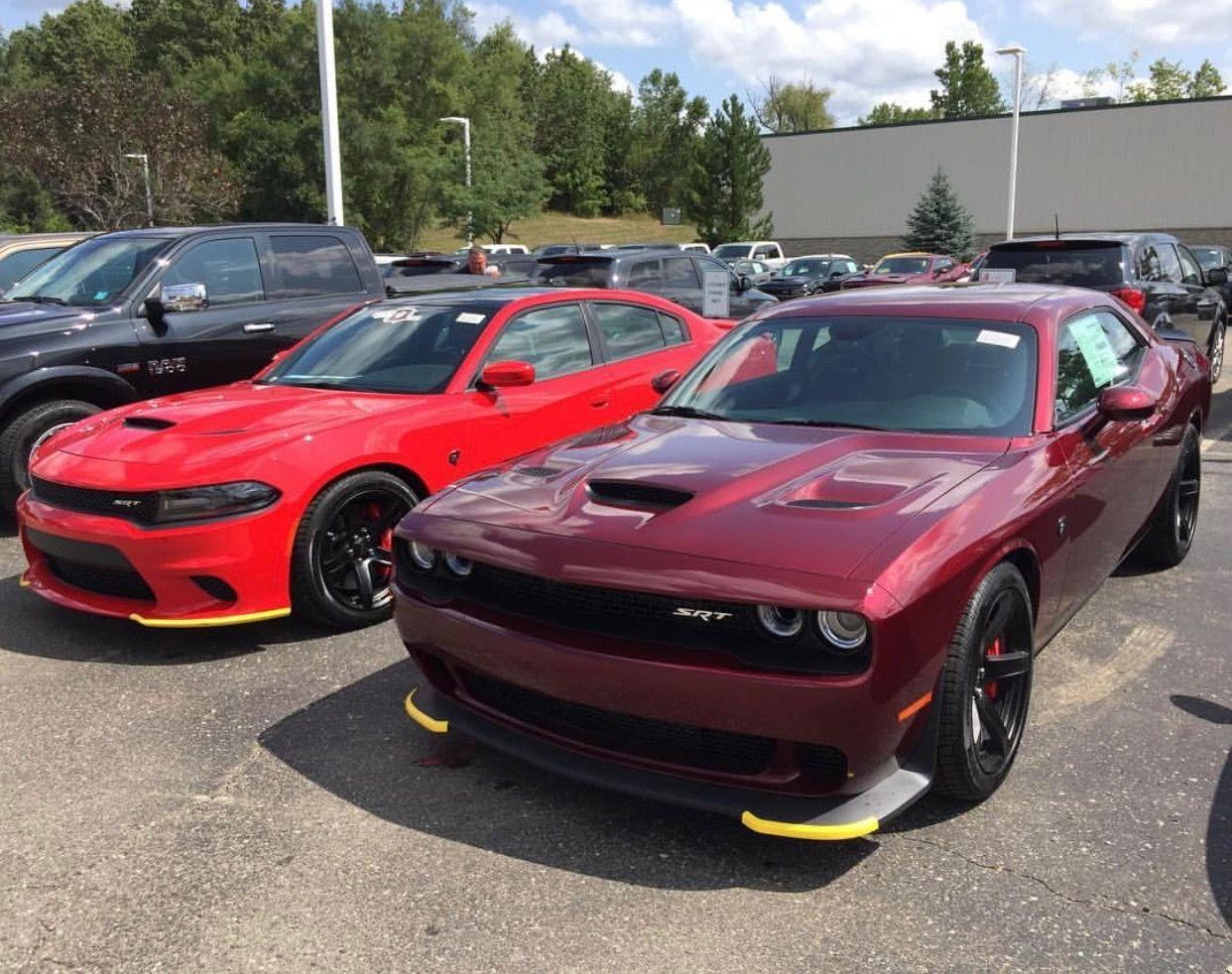 A Dodge Challenger Srt Hellcat Painted In Octane Red And A Dodge Charger Srt Hellcat Painted In T Dodge Charger Srt Dodge Challenger Srt Challenger Srt Hellcat
