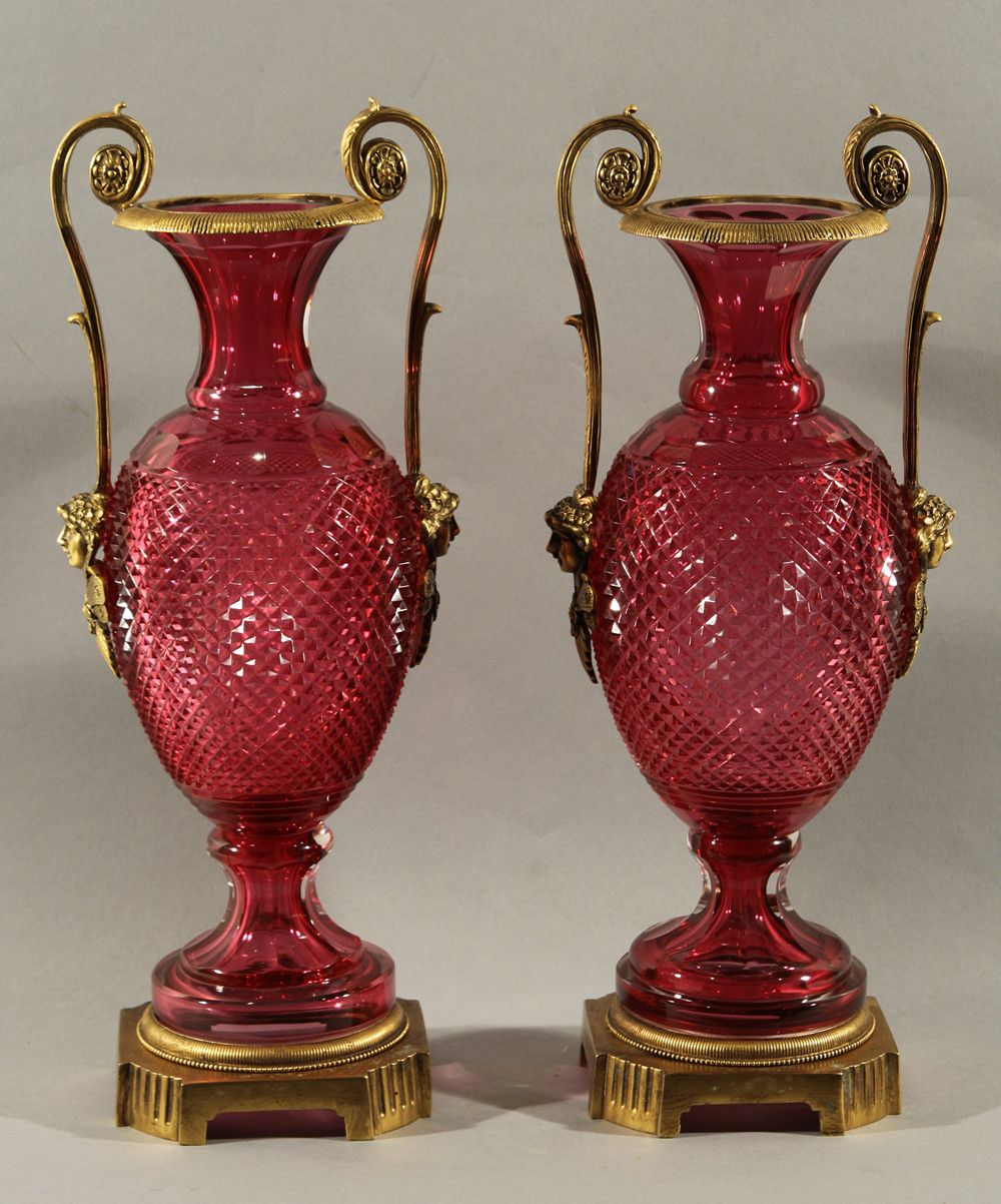 A pair of russian cut ruby glass ormolu mouted vase19th century a pair of russian cut ruby glass ormolu mouted century cut ruby red glass mounted with scrolling gilt bronze handles ornamented with projecting smiling reviewsmspy