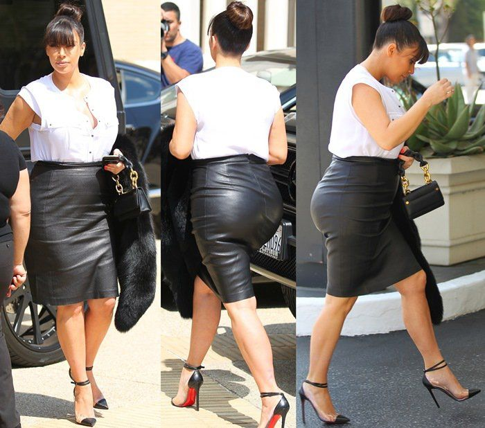 Pregnant Kim Kardashian in Tight Leather Skirt and Towering Heels ...