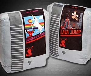 Now you can decorate your gaming room with some nostalgic pieces of 1980s gaming history when you buy yourself some Nintendo cartridge style pillows. Soft and comfy, these geeky throw pillows thankfully do not require you to blow them to get them to work as intended. #gamingrooms