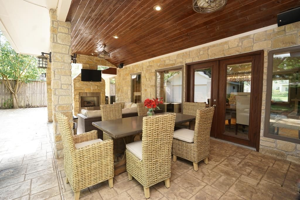 French Doors From Elegant Formal Dining Room Open To Incredible Outdoor Living