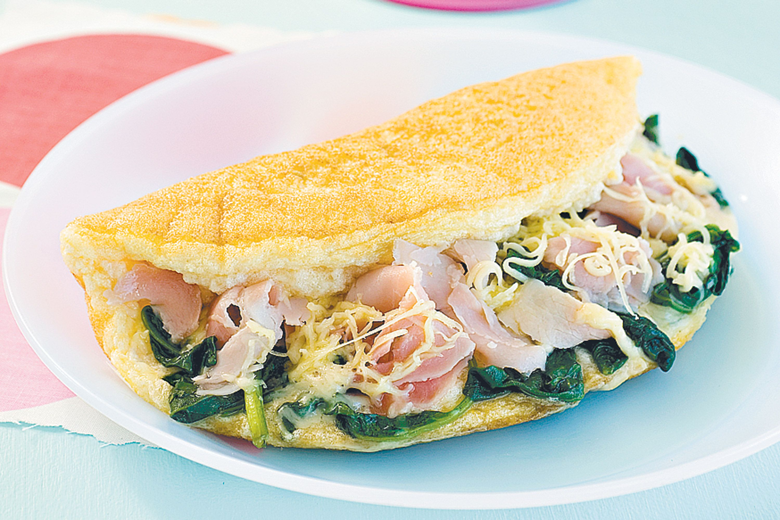 Fluffy omelette with ham spinach and swiss cheese ham