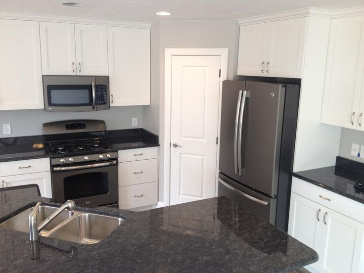 Dark gray kitchen cabinets with black appliances ge for Gray kitchen cabinets with white appliances
