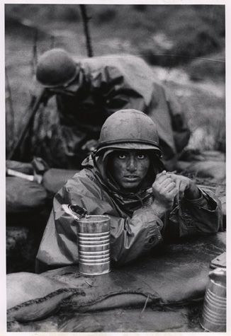 U.S. Marine inside the cone of fire at Con Thien, September/October 1967. Not usually shown as a full frame. Ducan. HRC.