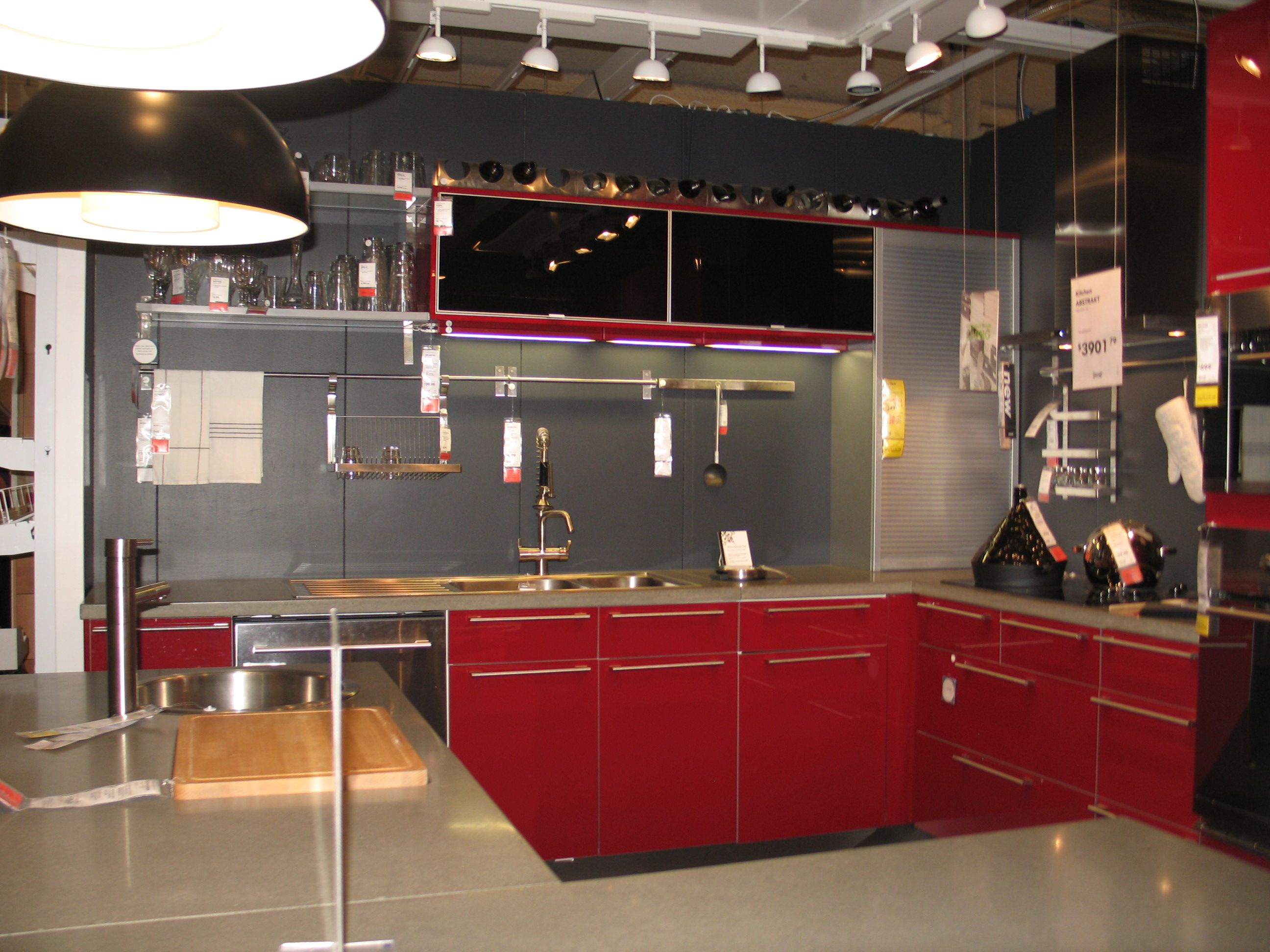 Simply love this elegant red kitchen design with the