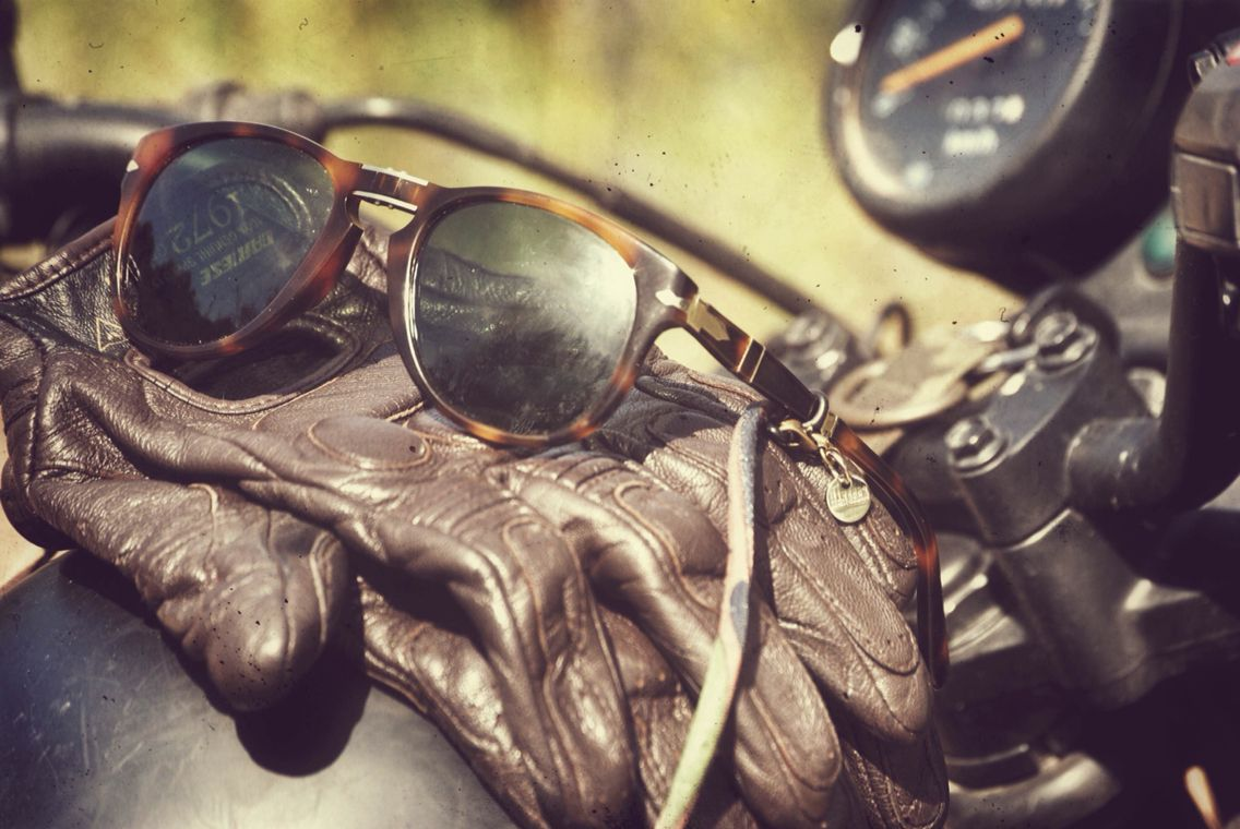 persol sunglasses, hangers, dainese leather gloves. cafe racer
