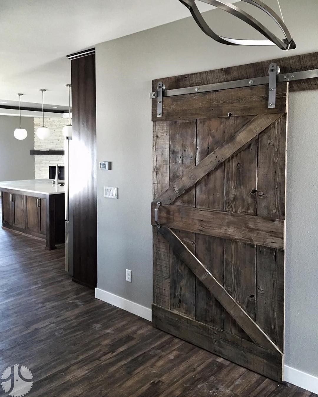 Rustica Hardware On Instagram We Love The Combination Of Stainless Steel Hardware And Dark Stained Wood Isn T T Wood Barn Door Staining Wood Dark Wood Stain