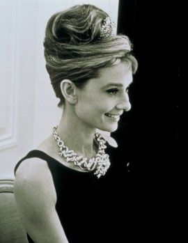 a54d2d3455a Audrey Hepburn wears Jean Schlumberger s Ribbon Rosette necklace with the  Tiffany Diamond for the film
