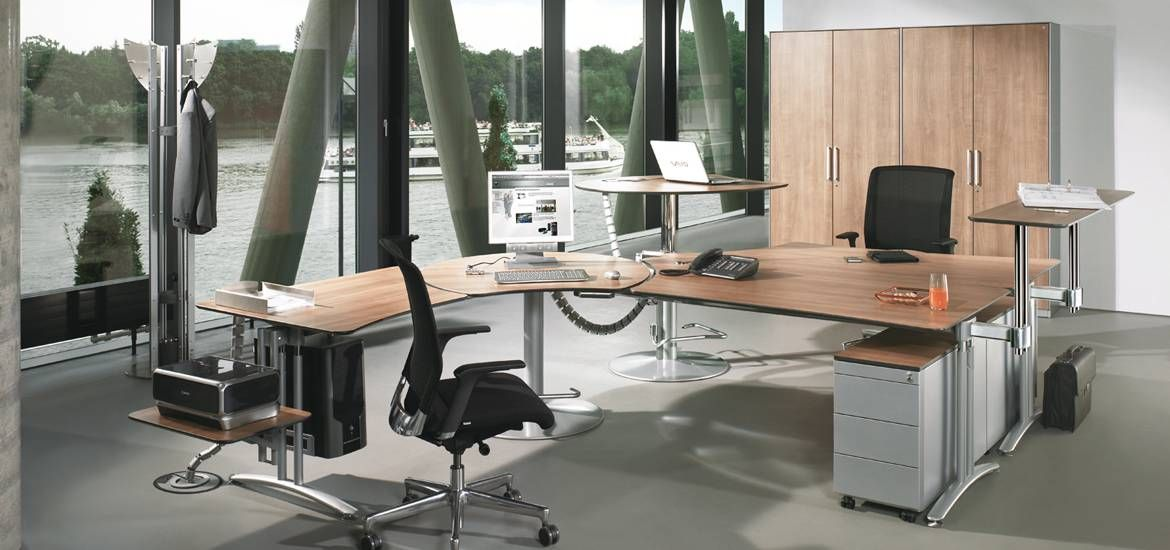 Sitting is so passé. Learn why.- Sit-Stand Executive desk