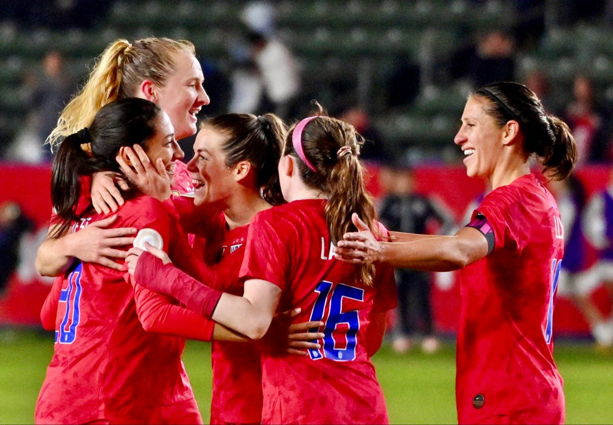 Christen Press 20 (left) celebrates with her USA