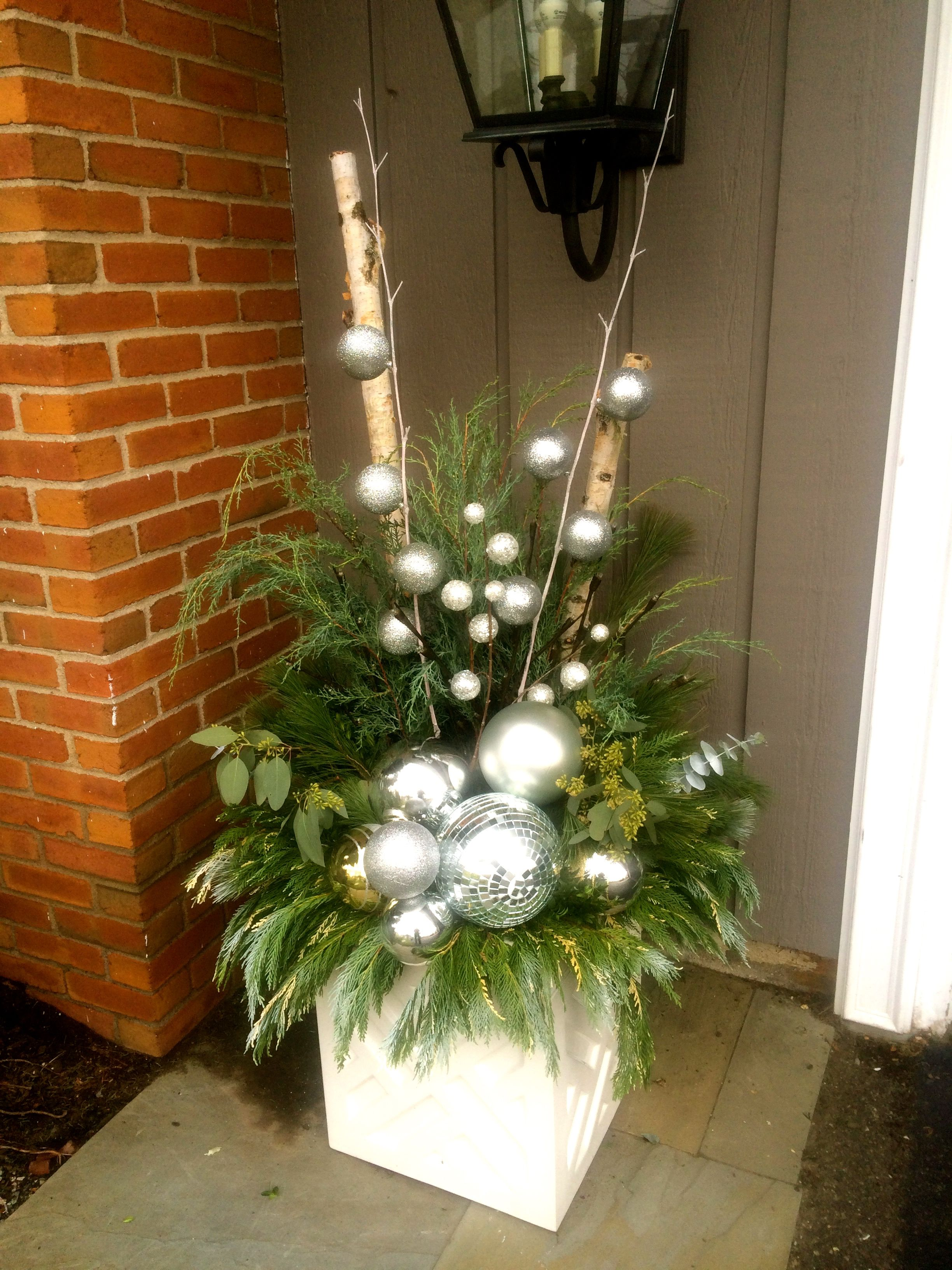 A Modern Twist On Holiday Planters Christmas Garden Decorations Outdoor Holiday Planters Christmas Urns